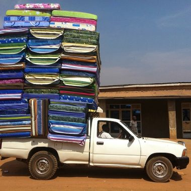 Vehicle carrying piled up mattress